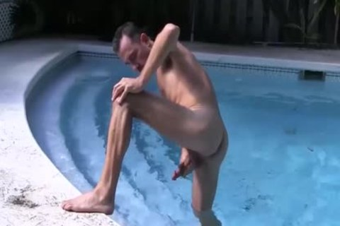 brunette chap Strokes His large wang In The Pool