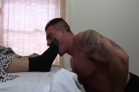 Tattooed And brawny Hunk Swallows His best Blokes Feet