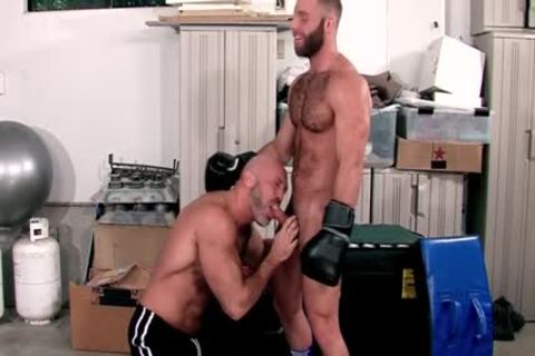 Muscled man blows ramrod