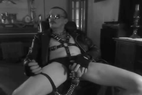 one more Horned Up Smoking Ball Stretching Session In My Leather Gear And Boots. With My tied Up penis And Stretched Balls On A Leash!!!
