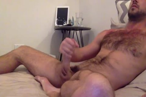 brunette hair hairy lad Strokes His enormous 10-Pounder'