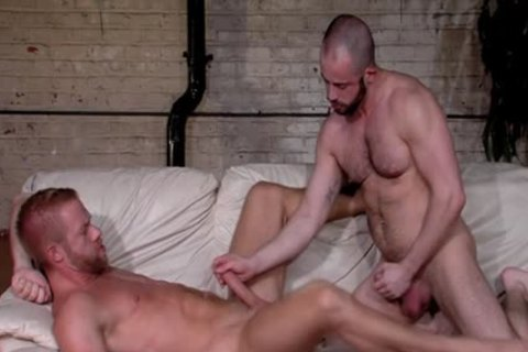 Muscled Hunk engulfing penis