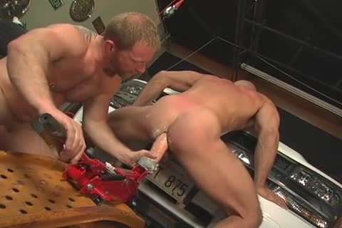 three males fucking In Garage