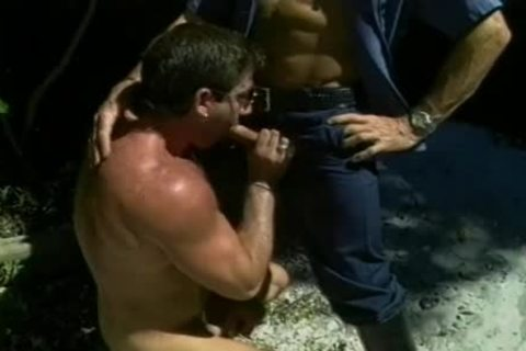Two tasty Cops get A boy On His Knees To suck cock