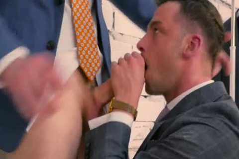 men IN SUIT IN AN INTIMATE moment