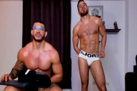 two muscular fellows Showing Their Body